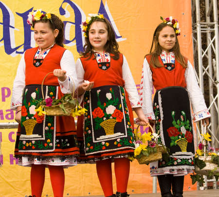 VARNA, BULGARIA - MARCH 26, 2016: people in national Bulgarian dresses on carnival devoted to the World Puppetry Day. Editorial