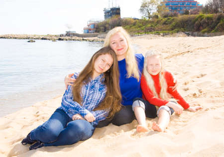 bulgaria girl: Family mother with two daughters on beach, recorded in Saint Constantine and Helen resort, Bulgaria. Stock Photo