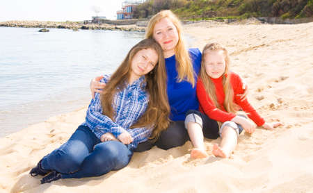 helen: Family mother with two daughters on beach, recorded in Saint Constantine and Helen resort, Bulgaria. Stock Photo