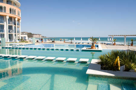 SAINT CONSTANTINE AND HELENA, BULGARIA - APRIL 10, 2015: swimming pool and beach of hotel Azalia in Saint Constantine and Helena is the oldest first sea resort of Bulgaria, exists from 19 century.