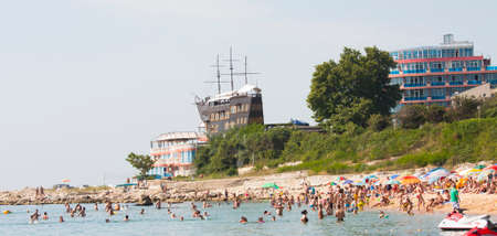 SAINTS CONSTANTINE AND HELENA, BULGARIA - JULY 02, 2015: Saints Constantine and Helena, the oldest first sea resort of Bulgaria, exists from 19 century - beach, hotel Sirius and restaurant Sirius in old sailing ship.