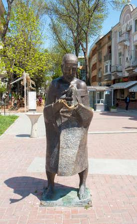 VARNA, BULGARIA - MAY 02, 2017: Monument to man with fish on boulevard knyaz Boris I Editorial