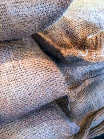 Sacks of raw coffee beans waitng to be roasted, Stock Photo