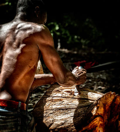 The begining of art.  A wood carver begings a new work. Stock Photo