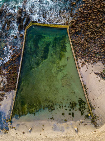 St James Tidal pool clear sea water but no swimmers. cape Town, South Africa.