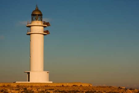 lighthouse on Formentera during sunset, beautiful blue orange sky