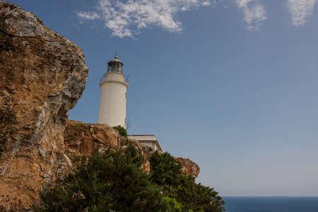 white lighthouse on the coast