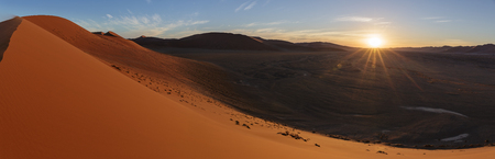 A panorama view at sunset from dune 45 at Sossusvlei in Namibia