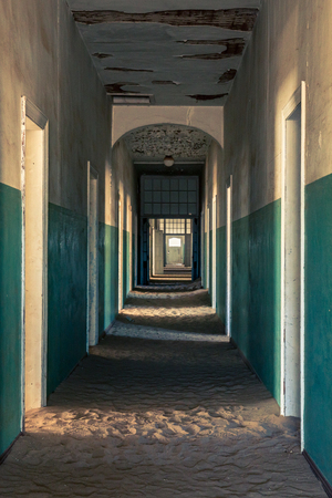A corridor in the historic hospital of the abandoned town of Kolmanskop in Namibia