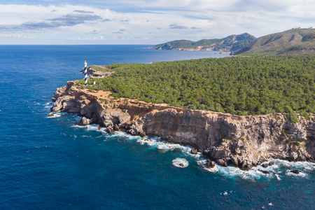 Drone shot of the northernmost point of Ibiza. The lighthouse of punta des moscarter.