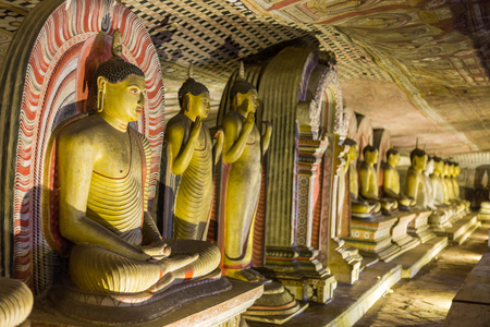 Many golden Buddha statues in the Dambulla Cave (Sri Lanka)