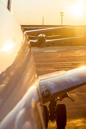 Airplane at sunset on the runway.
