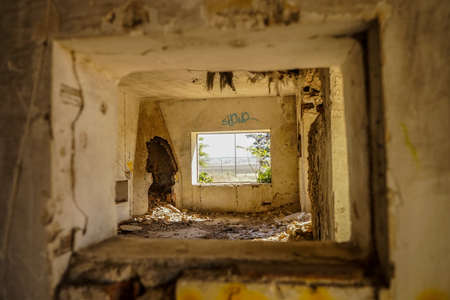 Window through the window and the fireplace in ruins. Stock Photo