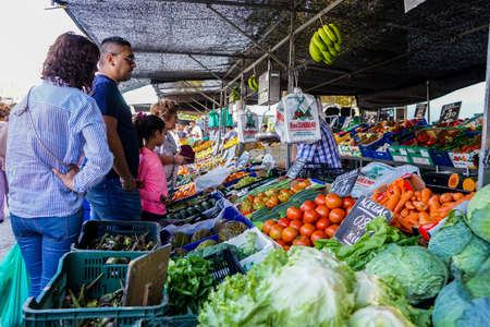 Street market in Madrid, Spain. People in a vegetables stand.