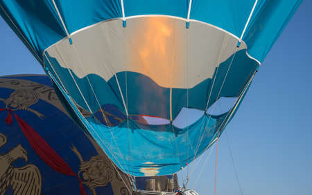 The flame is lit below a hot air balloon.