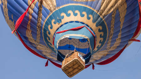 A hot air balloon floating. Editorial
