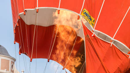 The flame into a hot air balloon in preparation to raise.Hot air balloon exhibition in Aranjuez,Madrid, September, 2017