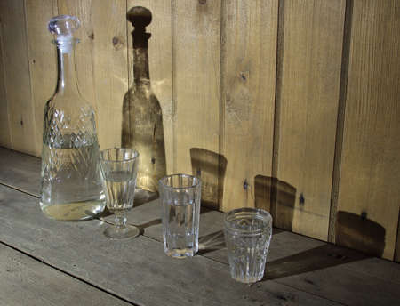 decanter: Decanter and 3 vodka glasses Stock Photo