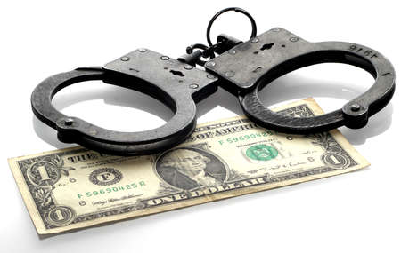 Handcuffs and coins isolated on white Stock Photo - 16759119
