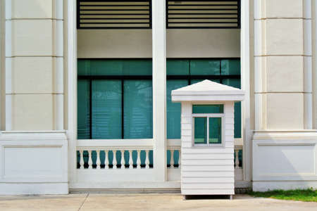 sentry: White sentry box and building Stock Photo