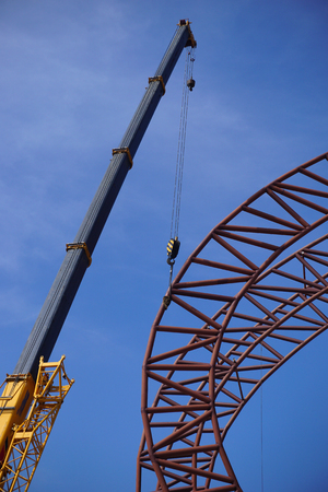 steel roof frame installation by mobile crane