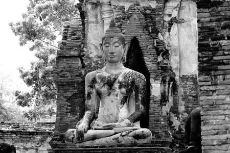 subduing: Ancient Buddha Statue In The Attitude Of Subduing Mara, Black And White