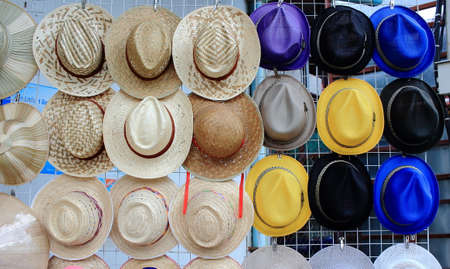 kratka: Row Of Vintage Weaving Hats Hanging On The Grille