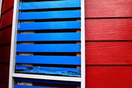 batten: Blue Wooden Batten On The Red Wooden Wall Stock Photo