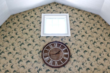 wooden clock: Wooden Clock On the Wall With Pattern of Wallpaper