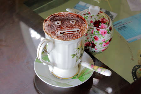 emotionless: Emotionless Face In Luxury Coffee Cup Stock Photo