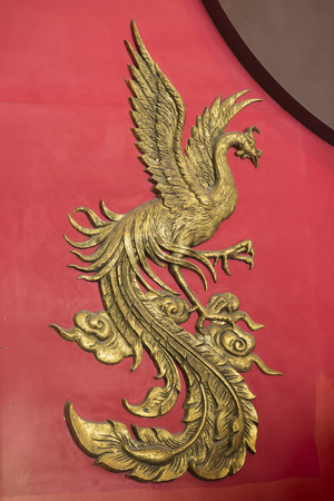 Phoenix carved from wooden in chinese style use color gold and red