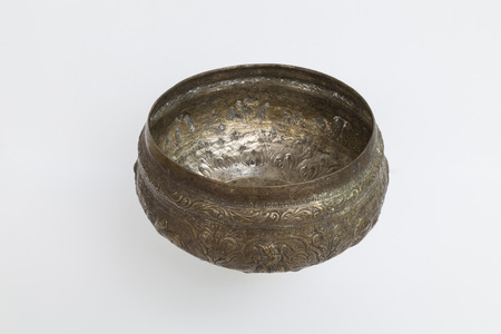 pinchbeck: This is a brass bowl on  white background someone call  pinchbeck water dipper  Stock Photo