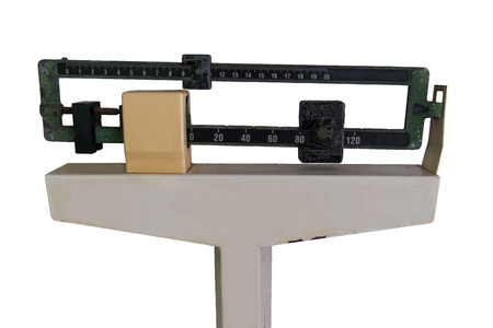 heavy weight: Old Medical Weight Scale isolated on white