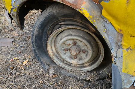 hubcap: Detail Shot of a Flat Tire on a Old Car Selection Focus on Tire