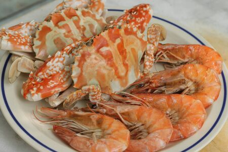 Steamed shrimp and crabs on dish photo