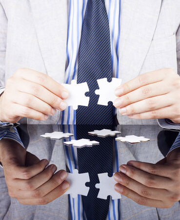 new business problems: a businessmen making puzzle