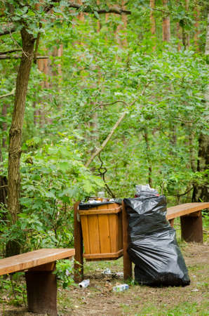 walking path: trash can along walking path in forest,