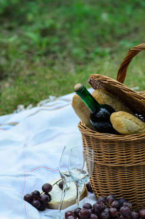 picnic basket and food in forest photo