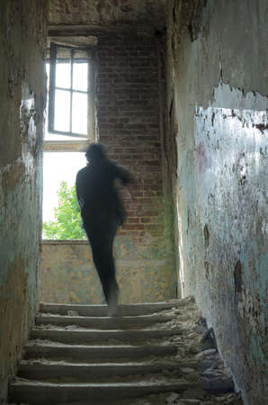 scared: alone person walking in ruins