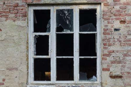 devastated: old window in devastated house