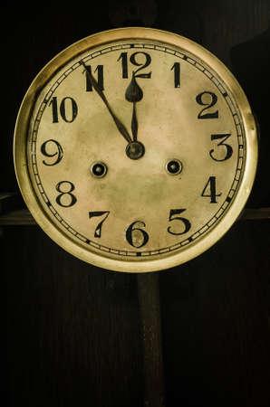 old antique golden dial clock photo