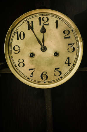 past midnight: old antique golden dial clock