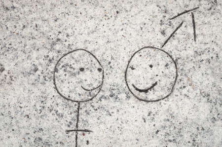 heterosexuality: closeup to couple drawing on sand background