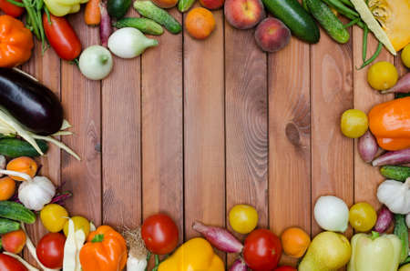 vegetables and fruits composition on wooden table photo