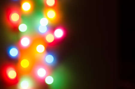 iluminated: Abstract defocused  multicolored bokeh lights background