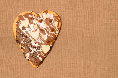 gingerbread cake: heart shape  gingerbread cake on brown background Stock Photo