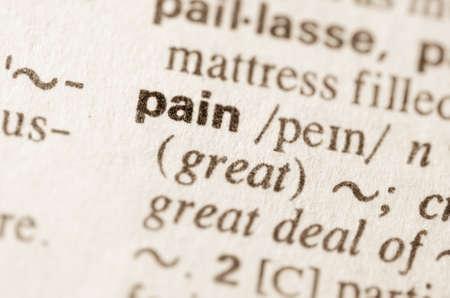 Definitie van het woord pijn in woordenboek Stockfoto