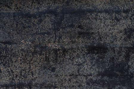 tar paper: weathered dark tar paper background texture