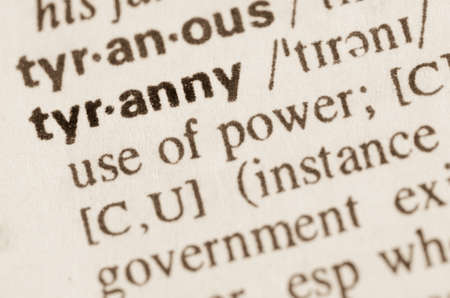 totalitarianism: Definition of word tyranny in dictionary Stock Photo