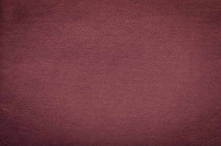 burgundy colour: closeup of burgundy leather texture background